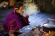 This minority woman is smoking a cheroot, a mild cigar that's popular in Myanmar.  Near Hsipaw, Myanmar (Burma)