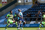Forest Green Rovers Manny Monthe(6) goes to challenge Wycombe Wanderers Adebayo Akinfenwa(20) during the EFL Sky Bet League 2 match between Wycombe Wanderers and Forest Green Rovers at Adams Park, High Wycombe, England on 2 September 2017. Photo by Shane Healey.