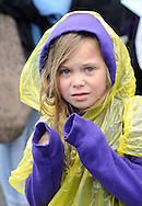 Julianna Mehlberger, 7, of Yardley, Pa. is covered in rain gear during the Newtown Business Association's Welcome Day Sunday May 1, 2016 in Newtown, Pennsylvania.  (Photo by William Thomas Cain)