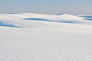 A vast scene of gypsum sand formations stetching deep into White Sands National Monument, New Mexico