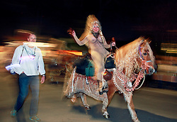 12 Feb 2015. New Orleans, Louisiana.<br /> Mardi Gras. A rider makes her way along Magazine Street  with the The Krewe of Muses. <br /> Photo; Charlie Varley/varleypix.com