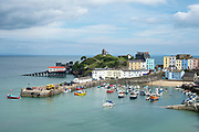 Pleasure boats - powerboats and yachts in harbour - seaside housing, lifeboat station and town, Tenby, Wales, UK
