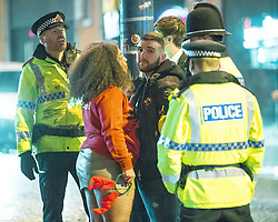 "© Licensed to London News Pictures . 23/12/2017. Manchester, UK. Police handcuff and detain a man after intervening to break up a fight . Revellers out in Manchester City Centre overnight during "" Mad Friday "" , named for being one of the busiest nights of the year for the emergency services in the UK . Photo credit: Joel Goodman/LNP"
