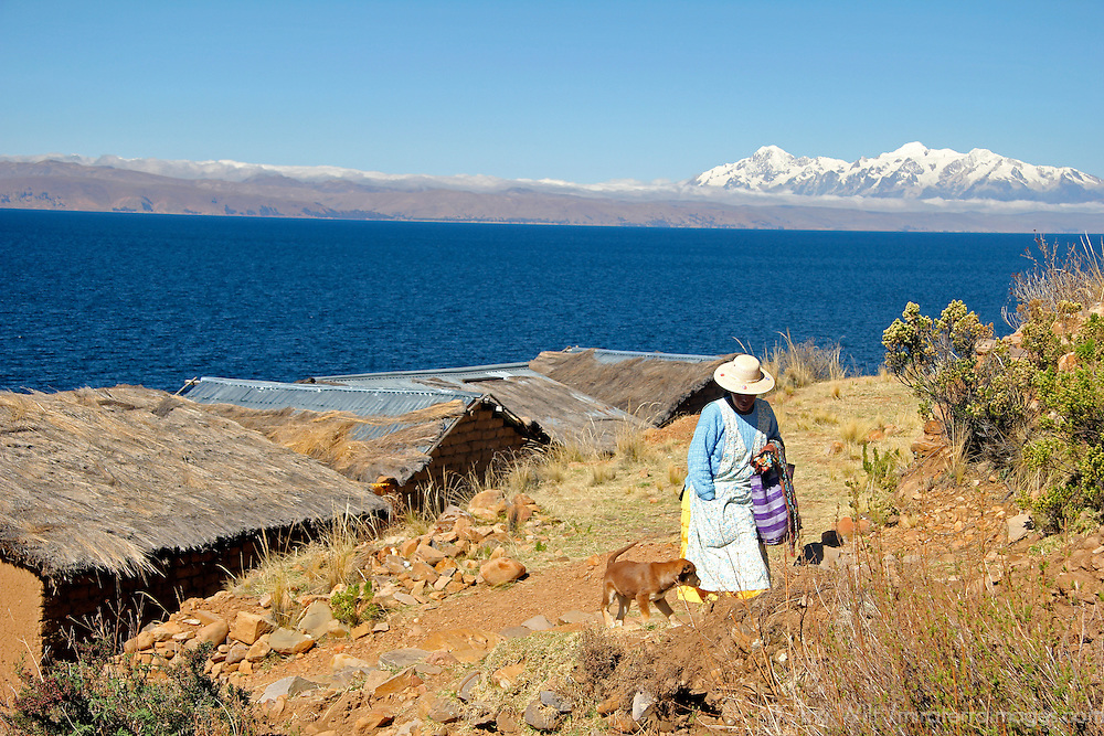 South America, Bolivia, Moon Island. Woman and dog on Moon Island of Lake Titicaca.