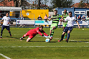 Guiseley's Jonny Maxted beats Forest Green Rovers Christian Doidge(9) to the ball during the Vanarama National League match between Guiseley  and Forest Green Rovers at Nethermoor Park, Guiseley, United Kingdom on 8 April 2017. Photo by Shane Healey.