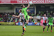 Forest Green Rovers Christian Doidge(9) beats Cheltenham Town's Taylor Moore(28) to the ariel ball during the EFL Sky Bet League 2 match between Cheltenham Town and Forest Green Rovers at LCI Rail Stadium, Cheltenham, England on 14 April 2018. Picture by Shane Healey.