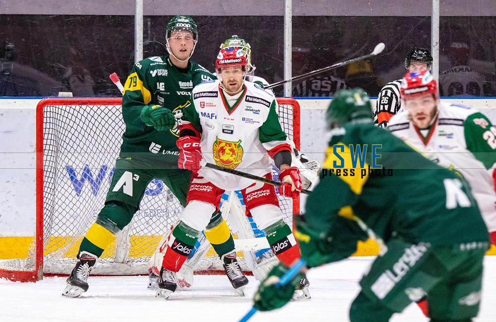 2019-12-02 | Umeå, Sweden: Björklöven (79) Emil Lundberg standing in front of Mora (45) Isak Wallin in HockeyAllsvenskan during the game  between Björklöven and Mora at A3 Arena ( Photo by: Michael Lundström | Swe Press Photo )<br /> <br /> Keywords: Umeå, Hockey, HockeyAllsvenskan, A3 Arena, Björklöven, Mora, mlbm191202