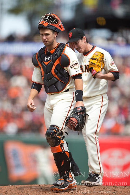 SAN FRANCISCO, CA - APRIL 26:  Buster Posey #28 of the San Francisco Giants walks past Tim Lincecum #55 after a meeting on the pitchers mound during the fifth inning against the Cleveland Indians at AT&T Park on April 26, 2014 in San Francisco, California. The San Francisco Giants defeated the Cleveland Indians 5-3.  (Photo by Jason O. Watson/Getty Images) *** Local Caption *** Buster Posey; Tim Lincecum