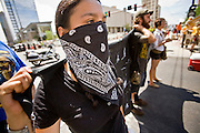 "29 JULY 2010 - PHOENIX, AZ: People protest in downtown Phoenix Thursday. Dozens of people were arrested during protests against SB 1070 across central Phoenix Thursday. US Judge Susan Bolton's ruling Wednesday stopped four of SB 1070's more than a dozen provisions from going into effect. She wrote, ""The court also finds that the United States is likely to suffer irreparable harm if the court does not preliminarily enjoin enforcement of these sections,"" she states in the ruling. ""The balance of equities tips in the United States' favor considering the public interest.""  PHOTO BY JACK KURTZ"