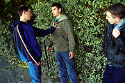 Two teenage boys facing off about to fight while another looks on Lambeth Walk South London c.2000