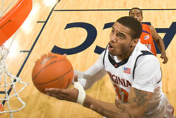 Virginia forward Mike Scott (32) makes a move to the basket against Clemson.  The Virginia Cavaliers defeated the #12 ranked Clemson Tigers in overtime 85-81 at the John Paul Jones Arena on the Grounds of the University of Virginia in Charlottesville, VA on February 15, 2009.
