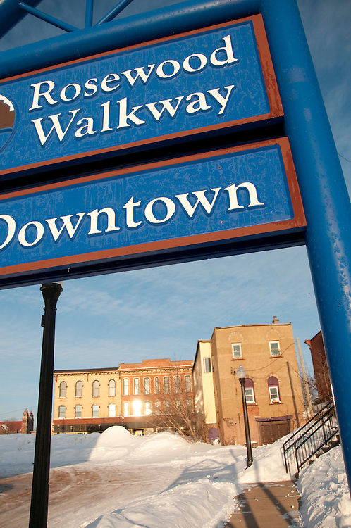 Signs and buldings in downtown Marquette Michigan in winter.