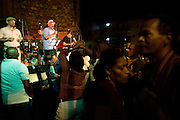 Dominican Republic:  Every Sunday evening, under open skies, against the backdrop of Las Ruinas del Monasterio de San Francisco, the sounds of Merengue, Salsa, Son and Bachata fill a Caribbean air. .In the historical Zona Colonial, Grupo Bonyé - a group of some 16 musicians, reminiscent of Cubas own Buena Vista Social Club, belt out Latin American and Caribbean melodies for free. Performing purely for pleasure...Neighbours, strangers, tourists, young and old Dominicans will tell you they learn to dance before they can walk!..Dance, talk, listen, drink, dance repeat. ..Space on the wooden, tiny dance floor is at a premium. But if you can stand on it, then you can dance on it. No barging, bumping. A little grinding bringing always a smile. ..play on!
