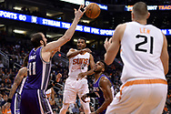 Mar 15, 2017; Phoenix, AZ, USA; Phoenix Suns forward TJ Warren (12) makes a pass in traffic in the first half of the NBA game against the Sacramento Kings at Talking Stick Resort Arena. Mandatory Credit: Jennifer Stewart-USA TODAY Sports