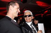 Rupert Everett and Karl Lagerfeld, Aids beneft during couture week, Pavilion D'Armee Nonville, 21 January 2004. © Copyright Photograph by Dafydd Jones 66 Stockwell Park Rd. London SW9 0DA Tel 020 7733 0108 www.dafjones.com