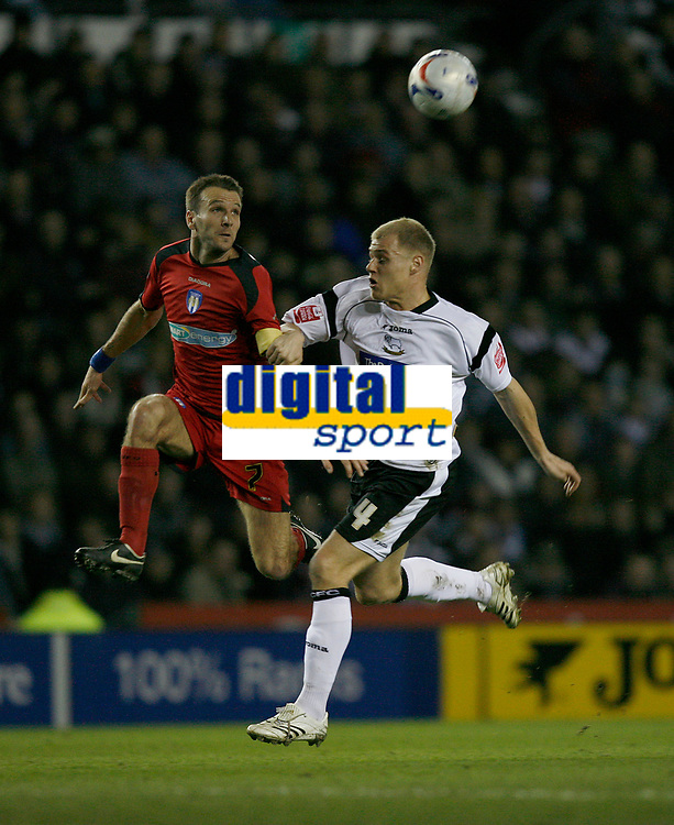 Derby's Jay McEveley (right) contests the ball with Colchester skipper Karl Duguid (left)