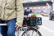 Brussels 23 March 2016 a girl on a bike with flowers in it to remeber the victims.She will put them somewhere here around maalbeek