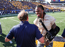 Oct 14, 2017; Morgantown, WV, USA; West Virginia Mountaineers head coach Dana Holgorsen celebrates with former West Virginia Mountaineers wide receiver Kevin White after beating the Texas Tech Red Raiders at Milan Puskar Stadium. Mandatory Credit: Ben Queen-USA TODAY Sports