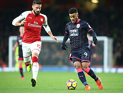 November 29, 2017 - London, England, United Kingdom - Huddersfield Town's Elias Kachunga beats Arsenal's Olivier Giroud..during Premier League match between Arsenal and Huddersfield Town at Emirates Stadium, London,  England on 29 Nov   2017. (Credit Image: © Kieran Galvin/NurPhoto via ZUMA Press)