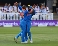 July 14, 2018 - London, Greater London, United Kingdom - Shikhar Dhawan of India celebrates with Virat Kohli of India after his catch of England's Eoin Morgan .during 2nd Royal London One Day International Series match between England and India at Lords Cricket Ground, London, England on 14 July 2018. (Credit Image: © Action Foto Sport/NurPhoto via ZUMA Press)