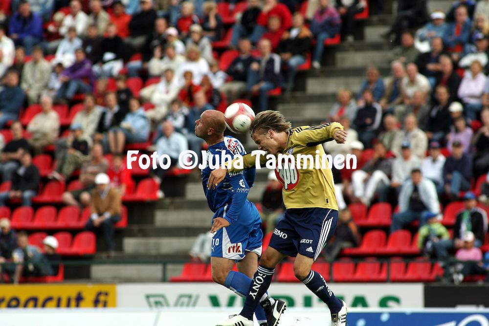 19.07.2006, Ratina, Tampere, Finland..Veikkausliiga 2006 - Finnish League 2006.Tampere United - HJK Helsinki.Ville Lehtinen (TamU) v Markus Halsti (HJK).©Juha Tamminen.....ARK:k