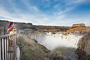 Family viewing Shoshone Falls from the lookout during really high water, spring run-off. Twin Falls, Idaho. MR