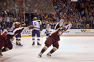 24 FEB. 2010 -- ST. LOUIS -- DeSmet's David Goodwin (9) celebrates after scoring the Spartans first goal in their game against CBC for the Mid States Club Hockey Association Challenge Cup at the Scottrade Center in St. Louis Wednesday, Feb. 24, 2010. Photo (c) copyright by Sid Hastings.