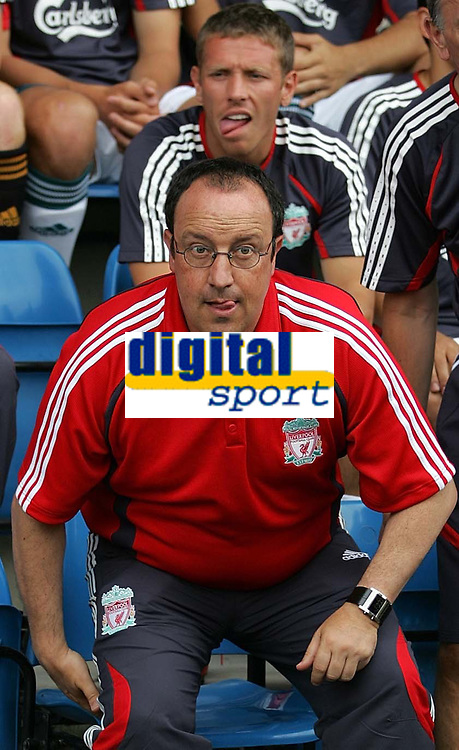 Photo: Paul Thomas.<br /> Crewe Alexandra v Liverpool. Pre Season Friendly. 22/07/2006.<br /> <br /> Liverpool manager Rafael Benitez gets ready for the match, while Craig Bellamy sits behind.