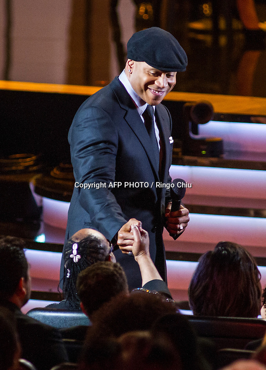 Host LL Cool J, top, shakes hands with Stevie Wonder in the audience during a concert, Stevie Wonder: Songs In The Key Of Life - An All-Star GRAMMY Salute, at Nokia Theatre L.A. Live on February 10, 2015 in Los Angeles, California. AFP PHOTO / Ringo Chiu