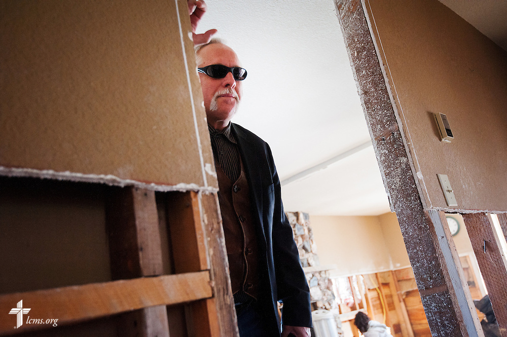 The Rev. Paul Rhode of Eternal Savior Lutheran Church surveys a flood-damaged home in Lyons, Colo., on Wednesday, Jan. 8, 2014. LCMS Communications/Erik M. Lunsford