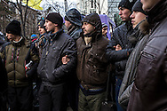 KIEV, UKRAINE - DECEMBER 4: Anti-government protesters control access to a street near several key government buildings on December 4, 2013 in Kiev, Ukraine. Thousands of people have been protesting against the government since a decision by Ukrainian president Viktor Yanukovych to suspend a trade and partnership agreement with the European Union in favor of incentives from Russia. (Photo by Brendan Hoffman/Getty Images) *** Local Caption ***