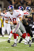 28 November 2011: Quarterback (10) Eli Manning of the New York Giants drops back to pass against the New Orleans Saints during the second half of the Saints 49-24 victory over the Giants at the Mercedes-Benz Superdome in New Orleans, LA.
