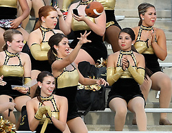 Klein Oak Strutter Jordan Sanchez, a senior, throws the ball back to the field after an errant pass by Cy-Creek quarterback Brandon Pryor found the stands during the first half of a high school football game, Saturday, September 3, 2011 at Berry Center in Cypress, TX.