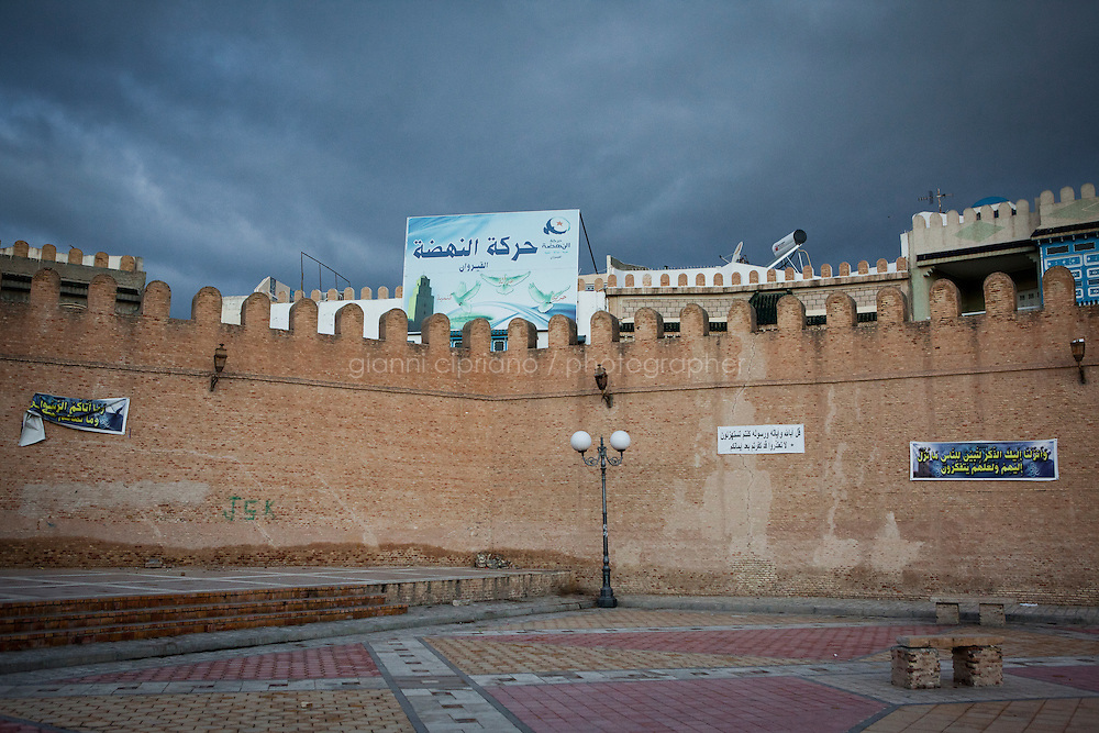 Kairouan, Tunisia - 18 December, 2011: A Nahda party banner for the Tunisian Constituent Assemby is placed aboce the Medina wall in Kairouan, Tunisia on 18 December, 2011. In the 24 October 2011 Tunisian Constituent Assembly election, the first elections since the Tunisian Revolution, the party won 40% of the vote, and 89 of the 217 assembly seats, far more than any other party. Said Ferjani, 57, senior member of the political and communication bureau of the Nahda (Renaissance) party, started his activism in the Negra mosque of his hometown Kairouan when he was 16 years old, debating on politics, philosophy, economy and world events. In 1989 former dictator Zine El Abidine Ben Ali turned against Nahda (or Ennahda) and jailed 25,000 activists. Said Ferjani was jailed and tortured. He then flew Tunisia and moved to the UK. He came back to Tunisia after 22 years, after former dictator Ben Ali flew the country.<br /> <br /> Gianni Cipriano for The New York Times