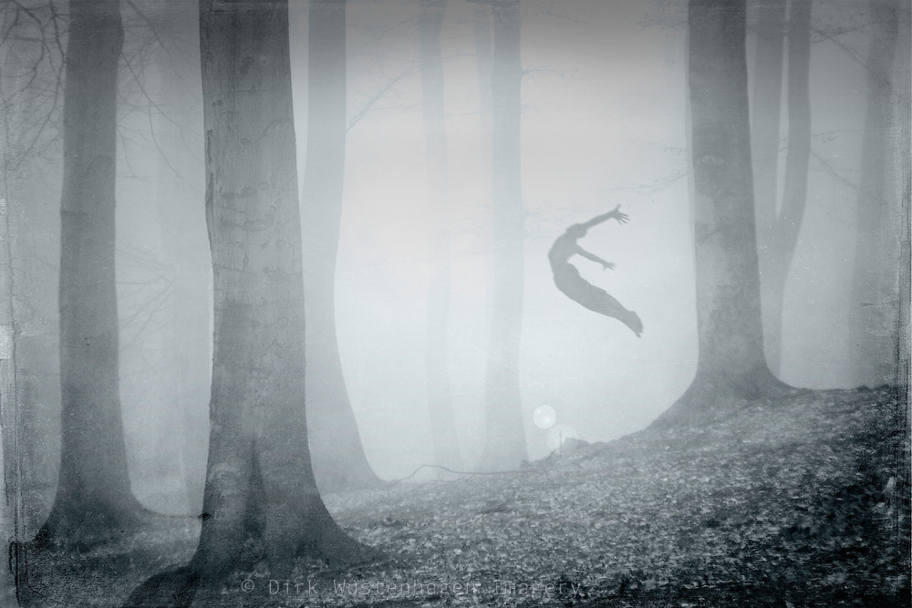 Surreal forest scne with a man jumping into the fog.<br /> <br /> Prints:<br /> http://society6.com/product/free-spirit-Adx_Print