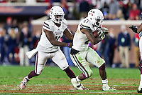 OXFORD, MS - NOVEMBER 26:  Damian Williams #11 hands off the ball to Aeris Williams #27 of the Mississippi State Bulldogs during a game against the Mississippi Rebels at Vaught-Hemingway Stadium on November 26, 2016 in Oxford, Mississippi.  The Bulldogs defeated the Rebels 55-20.  (Photo by Wesley Hitt/Getty Images) *** Local Caption *** Damian Williams; Aeris Williams