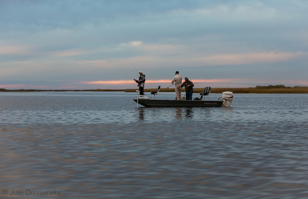 Men fishing in Point au Chien, Louisiana. Point au Chien is subject to coastal erosion. The area is inhabited by members of the Point-aux-Chien indian tribe and fishermen.