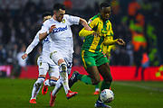 Jack Harrison of Leeds United (22) and Rekeem Harper of West Bromwich Albion (34) in action during the EFL Sky Bet Championship match between Leeds United and West Bromwich Albion at Elland Road, Leeds, England on 1 March 2019.