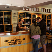 The cellar door at The Gibbston Valley vineyard in Gibbston Valley, Central Otago. The winery includes a cave which has been blasted out of the solid schist of the Central Otago mountains, and creates an ideal natural environment to mature award-winning wines, Gibbston Valley Wines,  Queenstown, Central Otago, New Zealand. 23rd March  2011. Photo Tim Clayton.