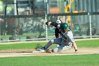 KELOWNA, BC - JULY 24:  Third baseman, Matt Voelzke #5 of the Kelowna Falcons, tags Nick Israel #10 of the Yakima Valley Pippins as he slides into third base at Elks Stadium on July 24, 2019 in Kelowna, Canada. (Photo by Marissa Baecker/Shoot the Breeze)