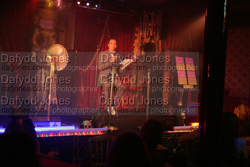 Julian Clary reading from his book, Book launch for Julian Clary's ' Murder Most Fab ',Simon Drake's House of Magic 9 Chapter Road, Kennington SE17. 14 August 2007.  -DO NOT ARCHIVE-© Copyright Photograph by Dafydd Jones. 248 Clapham Rd. London SW9 0PZ. Tel 0207 820 0771. www.dafjones.com.