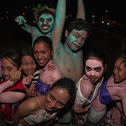 Dancers celebrating at the end of the Balayong Festival street dancing competition. The festival at the beginning of March commemorates the founding anniversary of the City of Puerto Princesa, Palawan, highlighted by balayong tree-planting, street dancing and a colourful floral parade depicting the Palawan cherry blossoms from which the festival derives its name. The Palawan cherry is one of the most popular flowering trees in Palawan and known by the locals as the Balayong, a beautiful tree that when it is in full bloom resembles the cherry blossoms of Japan.