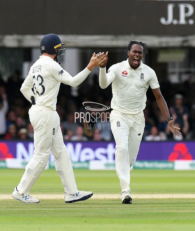 Wicket - Jofra Archer of England celebrates taking the wicket of David Warner of Australia with Jos Buttler of England during the International Test Match 2019 match between England and Australia at Lord's Cricket Ground, St John's Wood, United Kingdom on 18 August 2019.