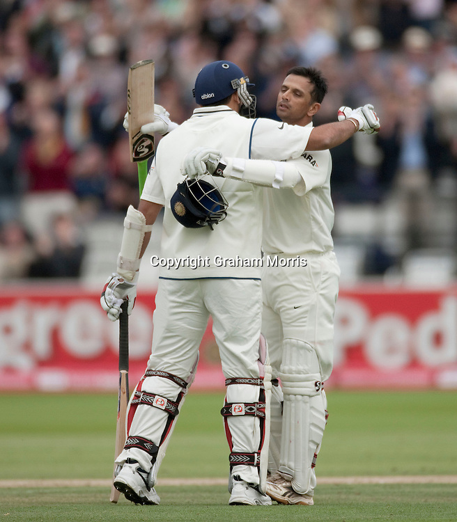 Rahul Dravid celebrates his century (with Zaheer Khan, left) during the first npower Test Match between England and India at Lord's Cricket Ground, London.  Photo: Graham Morris (Tel: +44(0)20 8969 4192 Email: sales@cricketpix.com) 23/07/11