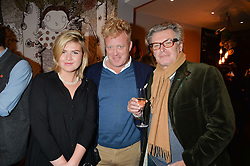 Left to right, MAISIE LITCHFIELD, TOM ASTOR and DUNCAN WARD at a Fondue evening hosted by Rose van Cutsem and her brother Tom Astor to celebrate the new ski Season with leading ski resort Meribel, Besson Clothing and ESF ski schools at Maggie & Rose, 58 Pembroke Road, London on 7th November 2016.