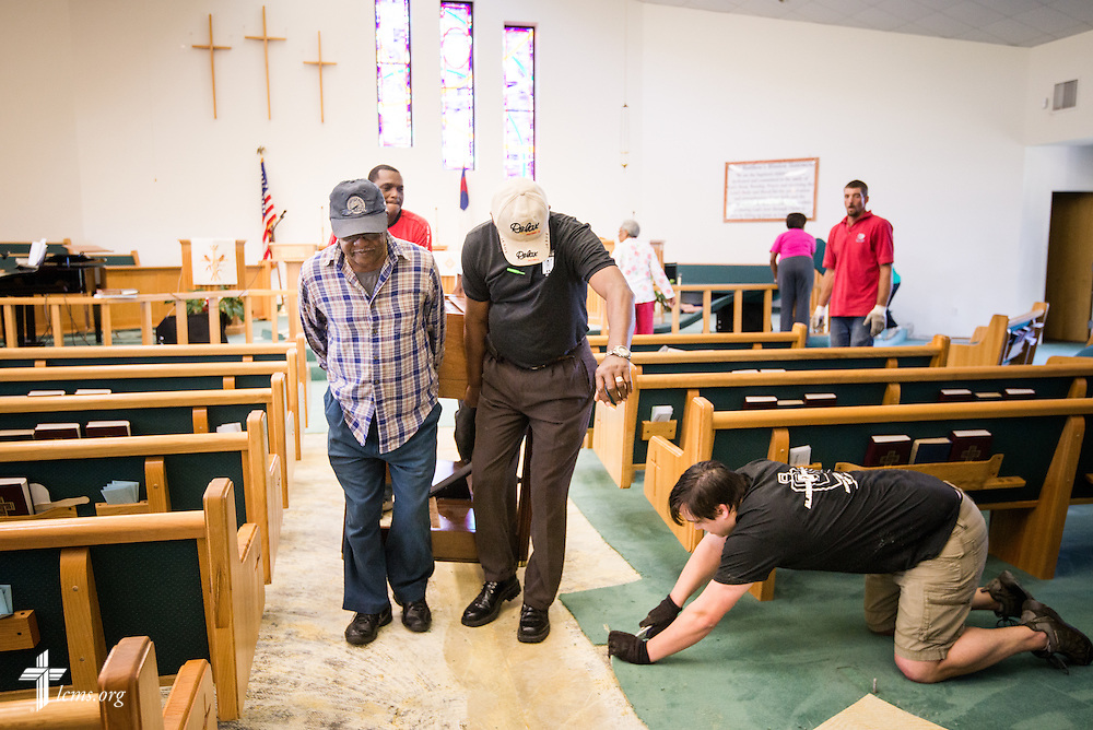 Volunteers and pastors from several Lutheran congregations help remove the organ, carpet, and pews from the flooded sanctuary of St. Matthew Lutheran Church in Pensacola, Fla., on Saturday, May 3, 2014. Torrential rainfall led to widespread flooding in the area earlier in the week. LCMS Communications/Erik M. Lunsford