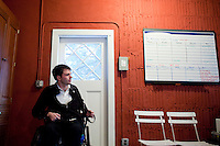 29 December, 2009. Bronxville, NY. Francesco Clark, 30, founder and president of Clark's Botanicals, is here in the garage of his home office where he ecercises 5 hours every day. Francesco Clark suffers a crippling cord injury due to a swimming pool diving accident on June 1, 2002. Clark's Botanicals was born out of the tragedy.<br /> With his central nervous system impaired, Francesco, who was then an assistant stylist at Harper's Bazar, lost the ability not only to walk, but even to sweat. This led to clogged pores and chronic breakouts. When neither over-the-counter nor prescriptive remedies worked, he turned to his father, Dr. Harold Clark, a physician trained in both traditional Western medicine and homeopathy.<br /> <br /> Together they developed botanically-based formulas that effectively rebalanced Francesco's skin, clearing it up entirely. Through word-of-mouth, other people discovered and fell in love with these products, and in 2005, Francesco began selling Clark's Botanicals on his website.<br /> ©2009 Gianni Cipriano for The New York Times<br /> cell. +1 646 465 2168 (USA)<br /> cell. +1 328 567 7923 (Italy)<br /> gianni@giannicipriano.com<br /> www.giannicipriano.com