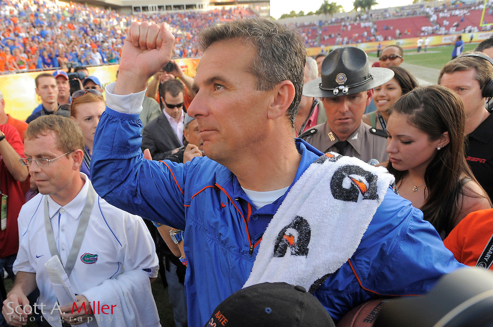 Florida Gators head coach Urban Meyer celebrates after the Gators 37-24 win over the Penn State Nittany Lions in the 2011 Outback Bowl at Raymond James Stadium on Jan. 1, 2011 in Tampa, Florida. .. ©2010 Scott A. Miller