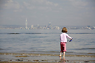Portsmouth skyline as seem on a misty morning from Puckpool beach on the Isle of Wight