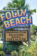 Folly Beach, South Carolina, USA. 03 September 2019. The Folly Beach town welcome sign lists the mandatory evacuation order and when access to the island will be stopped ahead of Hurricane Dorian September 3, 2019 in Folly Beach, South Carolina. The slow moving monster storm devastated the Bahamas and is expected to reach Charleston as a Category 2 by Thursday morning.